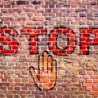 Graffiti Stop Letters Hand Brick Wall Palm 61008666